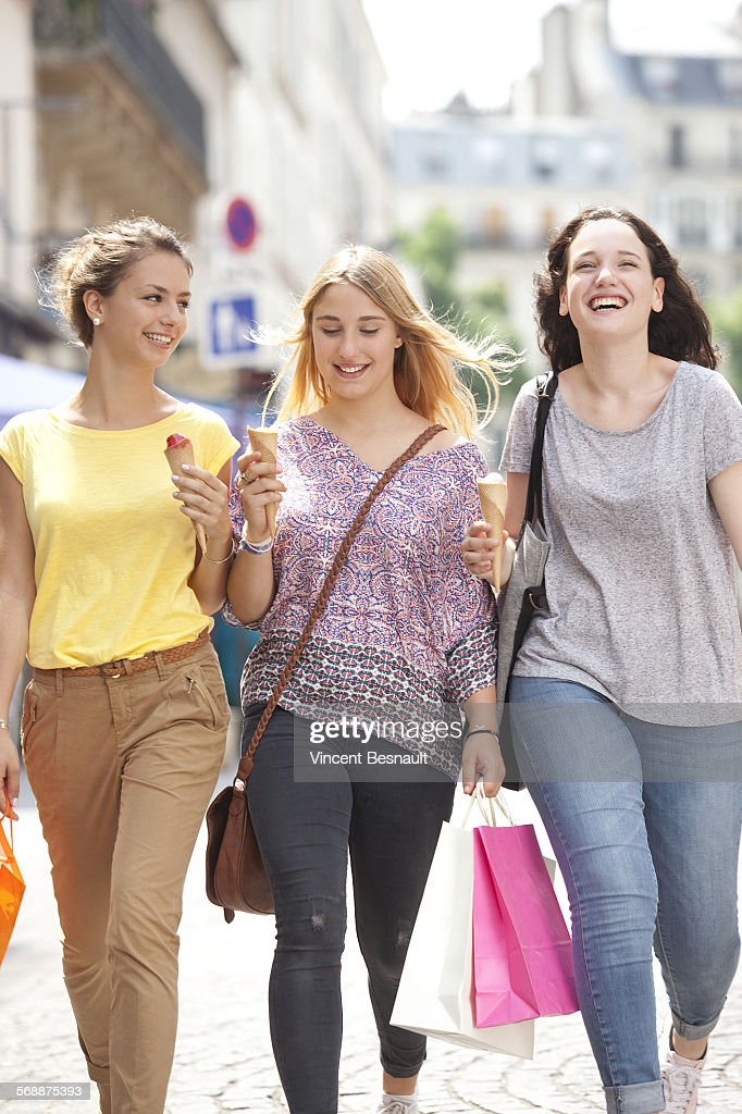 Three girls shopping in the street : Stock Photo