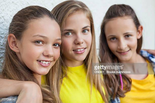 Three girls smiling together
