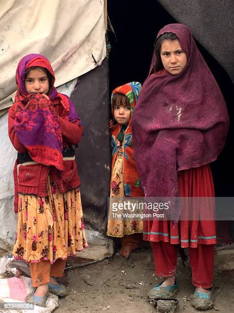 Three girls stand outside the tent where they live in a settlement of returned war refugees in Kabul on January 24 2017 The UN says up to 700000...