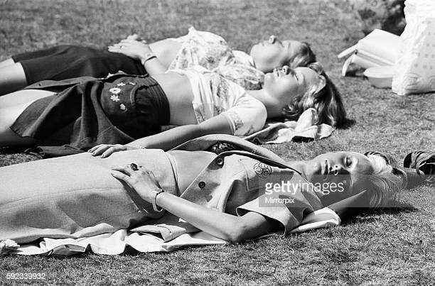 Three girls sunbathing in Birmingham during the summer heatwave of 1976 28th June 1976