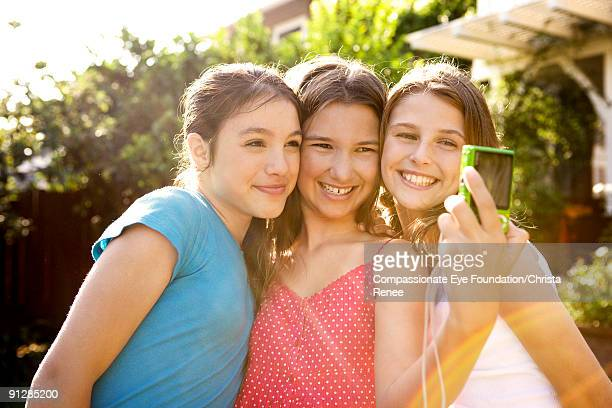 three girls taking a picture of themselves