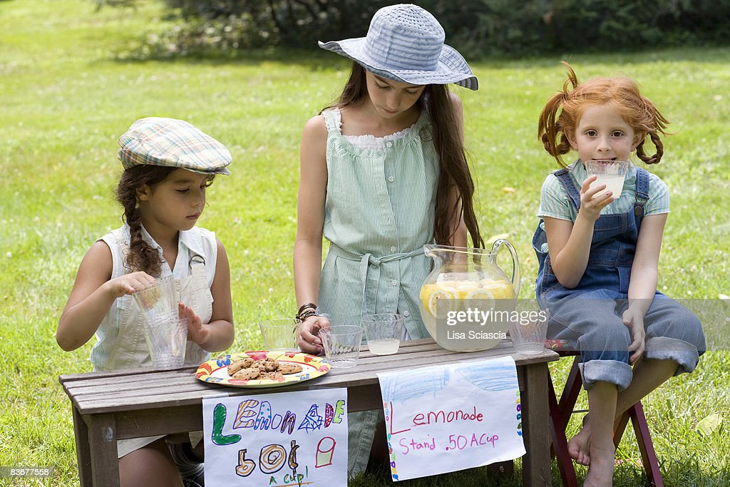 Three girls with a lemonade stand : Stock Photo