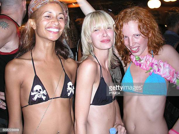 Three glamourous clubbing girls Ibiza 2004