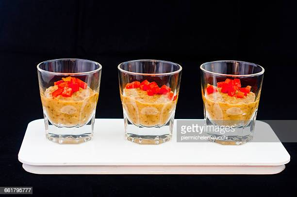 Three glasses of cold vegetable soup with chopped chili