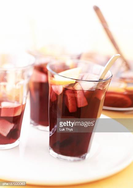 Three glasses of Sangria, bowl in background.
