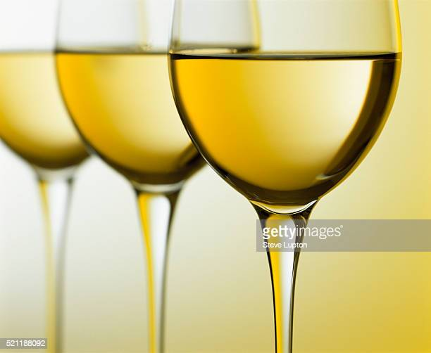 three glasses of white wine - white wine stock pictures, royalty-free photos & images