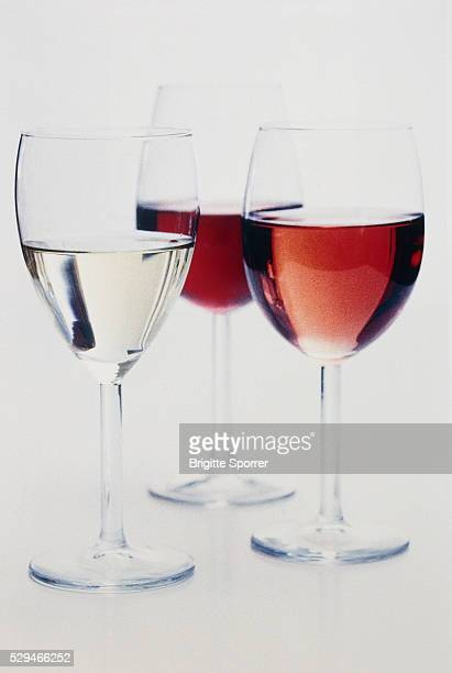 Three glasses with red wine
