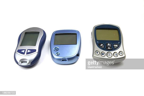 Three Glucose Testers of Various Brands