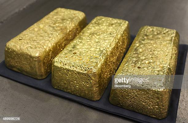 Three gold bars each weighing 25 kilogrammes sit on display at the Verninsky GOK gold mine and processing plant operated by Polyus Gold International...