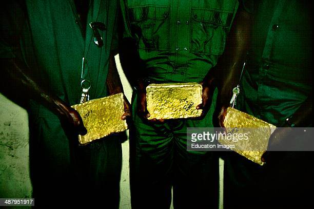 Three gold bars equaling one million dollars of pure gold. The Ashanti Goldfields in Obouasi in the Ashanti Region of Ghana, West Africa. The Ashanti...