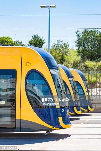 three gold coast light rail trams parked up in depot - gold coast queensland stock pictures, royalty-free photos & images
