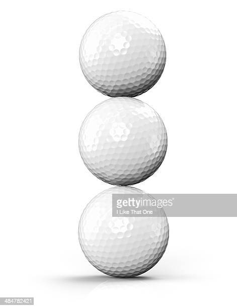 Three golf balls stacked on-top of each other