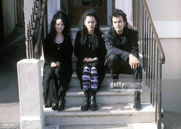 Three Goths sitting on some steps in Whitby, Yorkshire, UK for Vampire Society weekend, 1992.