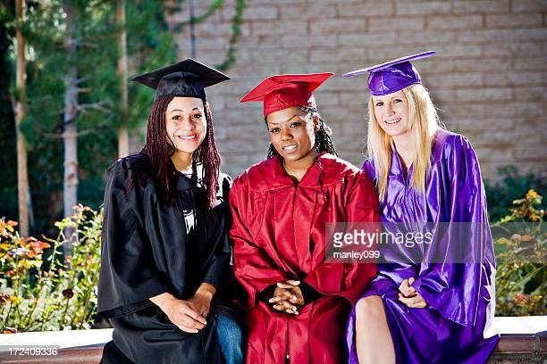 three graduation girls sitting down