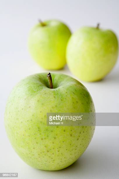 three green apples - newhealth stock photos and pictures