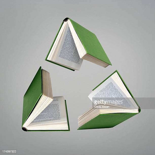 Three green books resembling a recycling logo