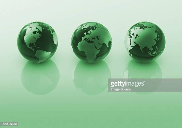 Three green globes