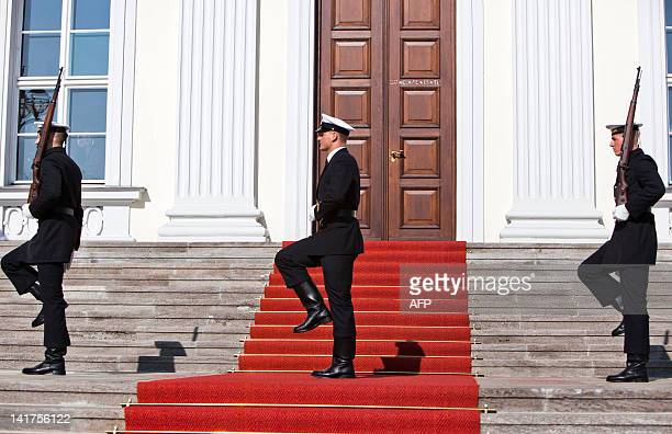 Three guards stand on the stairs of the Bellevue Presidential Palace on March 23, 2012 in Berlin. Joachim Gauck was elected president with an...