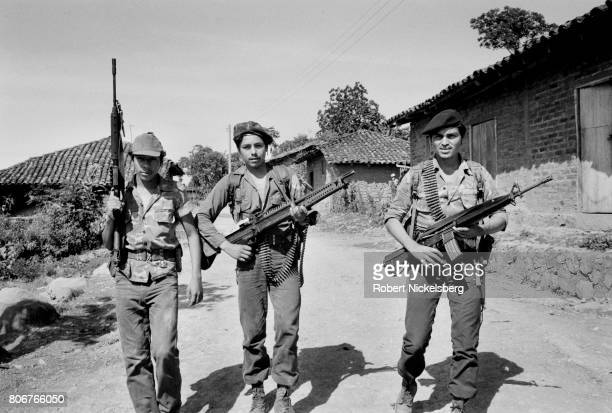 Three guerrilla fighters from the Popular Revolutionary Forces guerrillas patrol a street in Jucuarán El Salvador August 1 1983 At the time the...
