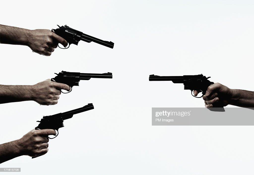 Three guns against one : Stock Photo
