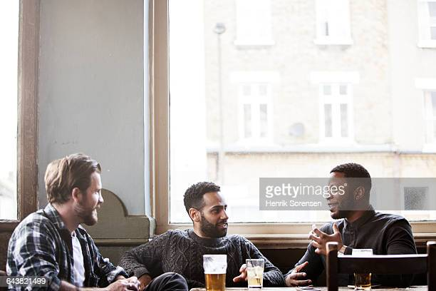 three guys at a pub - pub stock pictures, royalty-free photos & images