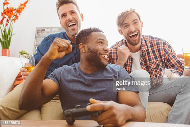 Three guys playing video games