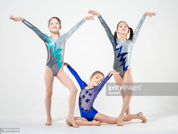 three gymnastic sisters - little girls doing gymnastics stock photos and pictures