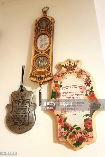 three hamsa symbols with a blessing for the home inscribed within - hand of fatima stock photos and pictures