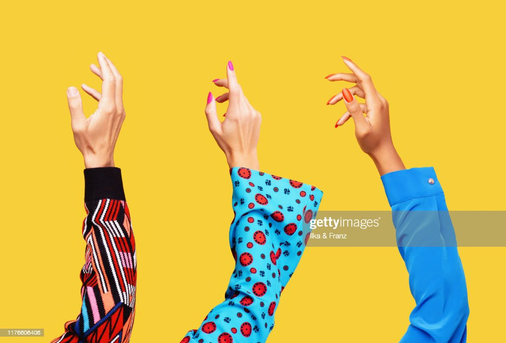 Three Hands in the Air : Stock Photo