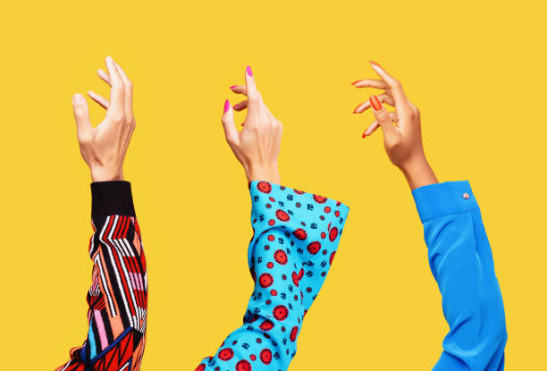 three hands in the air - human hand stock pictures, royalty-free photos & images