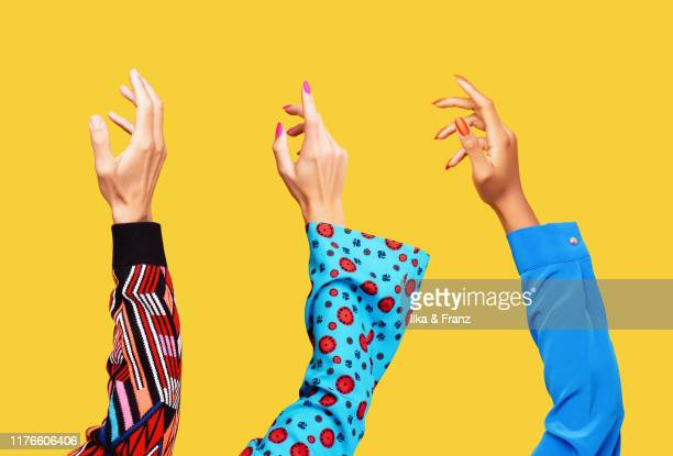 three hands in the air - long sleeved stock pictures, royalty-free photos & images