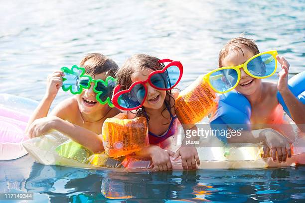 three happy children - armband stock pictures, royalty-free photos & images