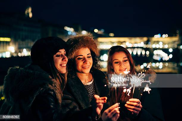 Three Happy Friends Celebrate Together With Sparklers