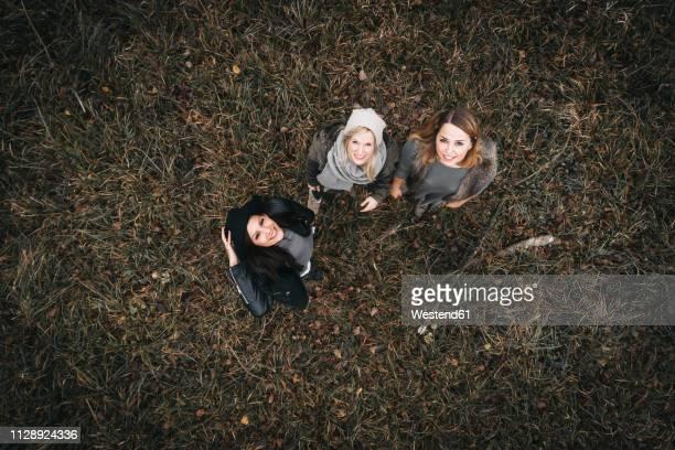 three happy friends in autumnal nature, aerial view - blick nach oben stock-fotos und bilder