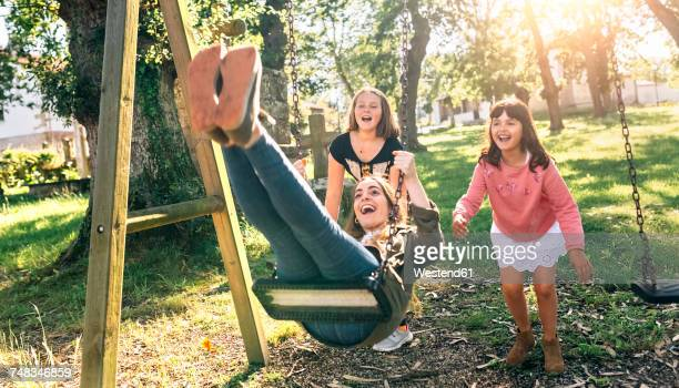 Three happy girls on a playground