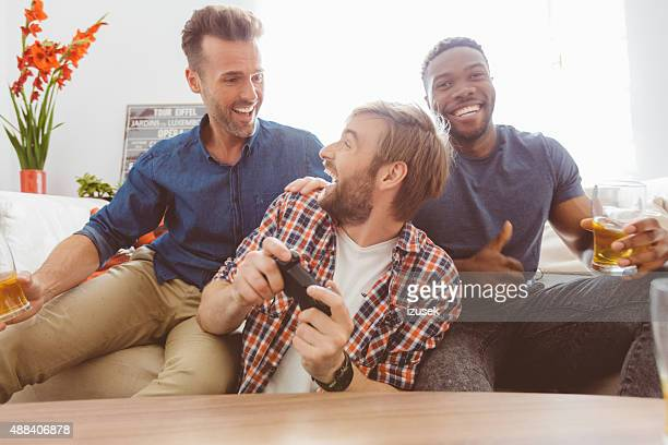 Three happy guys playing video games