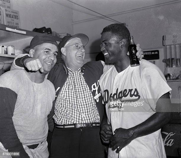 Three happy members of the unpredictable Dodgers do some celebrating in the Brooklyn Dodgers dressing room at Ebbets Field, September 29th, after the...