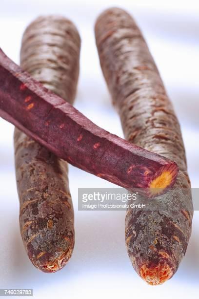 Three heritage carrots, partly peeled