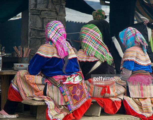 Three Hmong Women Wearing Colourful Clothing In Bac Ha, Vietnam