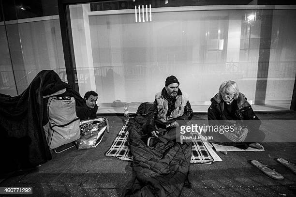 Three homeless people are seen on the street on October 27 2014 in London England