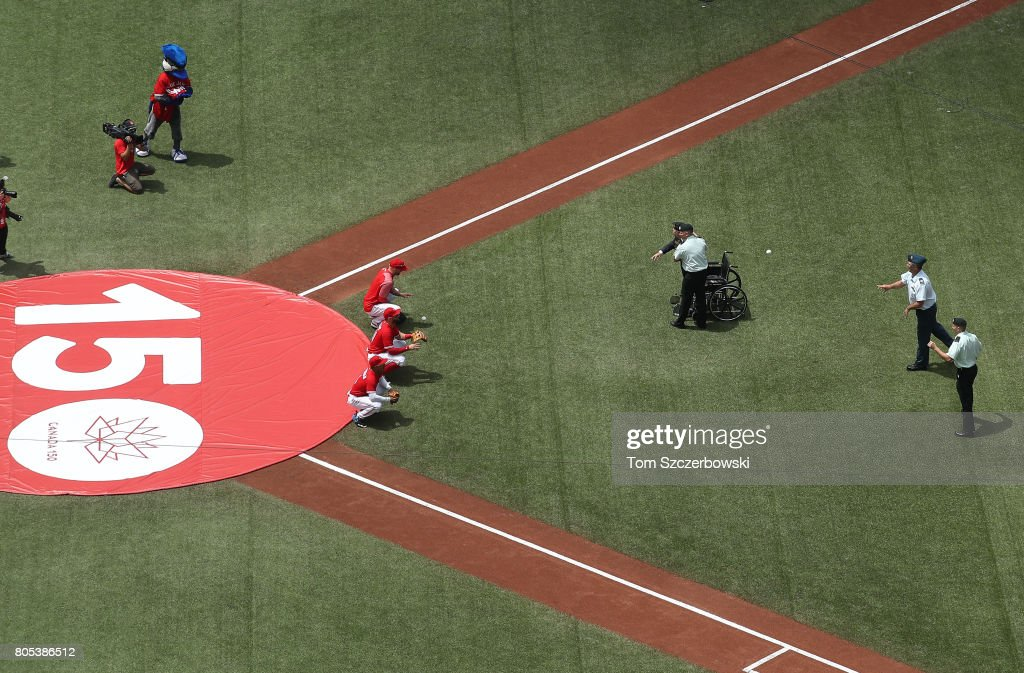 Three Honourable Members of the Canadian Armed Forces throw out the opening pitches on Canada Day on the 150th anniversary of the founding of the country before the start of the Toronto Blue Jays MLB game against the Boston Red Sox at Rogers Centre on July 1, 2017 in Toronto, Canada.