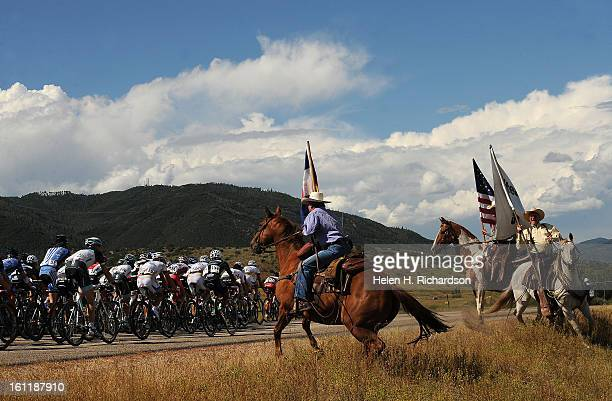 Three horseback rider stead their horse as they try to greet the peloton as it starts to pick up speed near the town of Steamboat Springs The Pro...