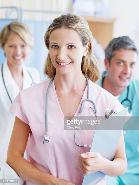 Three hospital workers smiling