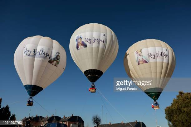 Three Hot Air Ballons, one for each of the Three Wise Men , fly over the ground where children and parents wait to greet them on January 5 in Las...