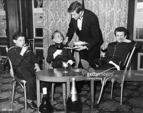 Three hotel page boys seen here relaxing at the Cafe Royal London