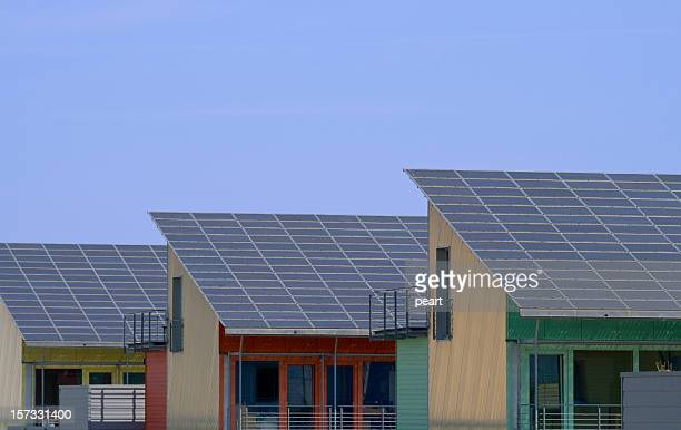 three houses with solar panels - solar mirror stock pictures, royalty-free photos & images