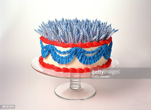 Three hundred candles on patriotic cake