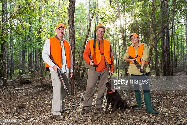 three hunters with hunting dog - shotgun stock pictures, royalty-free photos & images
