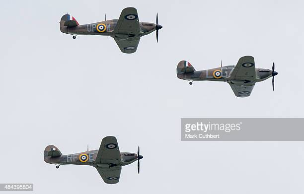 Three Hurricane fighters take part in a Battle of Britain flypast on August 18, 2015 in Biggin Hill, England. A total of 18 Spitfires and six...