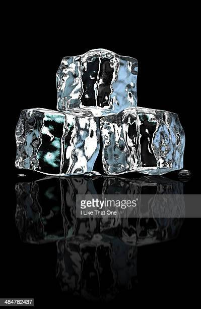 three ice cubes stacked - atomic imagery ストックフォトと画像